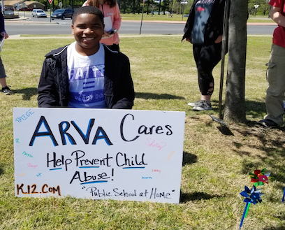 ARVA Student holding sign