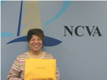 NCVA Volunteer holding envelope full of Valentines