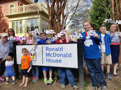 TNVA Students in front of Ronald McDonald House Sign
