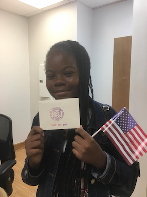 Student holding American flag